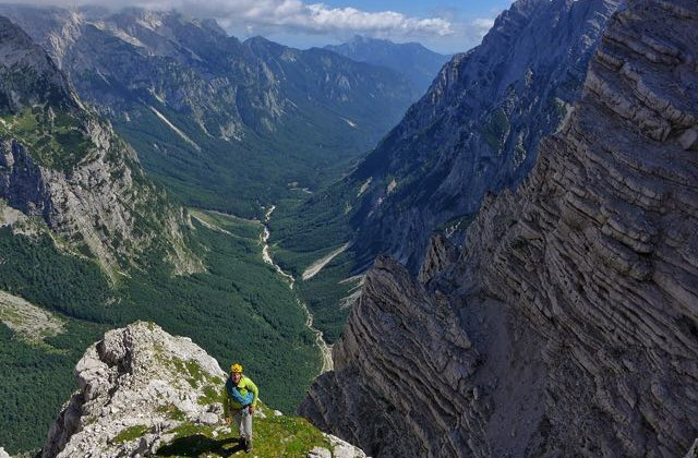 Photo by Marko Prezelj Steve House approaching the Sphinx Wall, Triglav's North Face, Slovenia. July 2015.